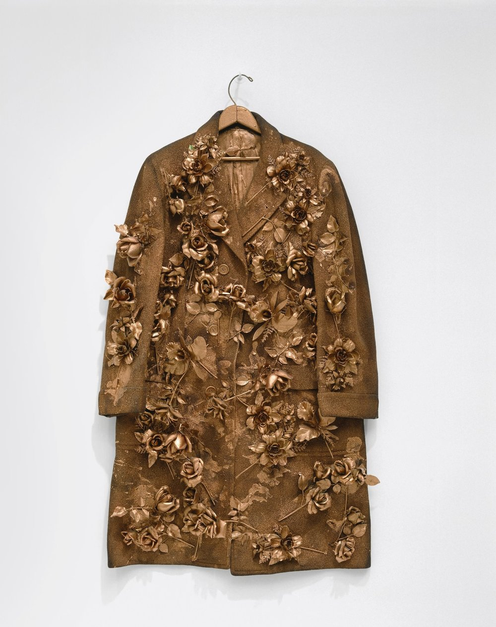 Yayoi Kusama   Flower Overcoat , 1964 (Cloth overcoat, plastic flowers, metallic paint, and wood hanger) Hirshhorn Museum and Sculpture Garden, Washington, DC. Joseph H. Hirshhorn Bequest and Purchase Funds, 1998 (98.38). © Yayoi Kusama Photo credit: Lee Stalsworth