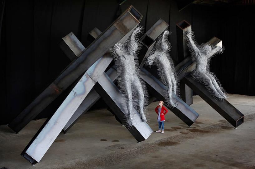 'golgotha', 2011, scultura metallo e appendiabiti by david mach foto via designboom