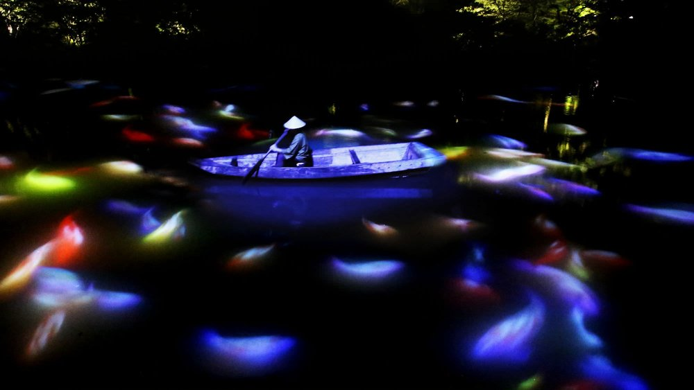 "Teamlab, ""Drawing on the water surface created by the dance of koi and boats"""