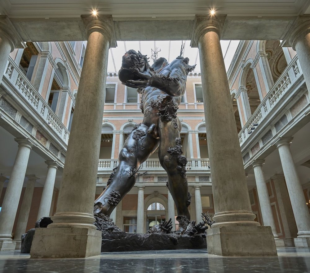 "Damien Hirst, Demon with Bowl, 2014, as installed in Palazzo Grassi in ""Treasures from the Wreck of the Unbelievable."" Photo by Prudence Cuming Associates, © Damien Hirst and Science Ltd. All rights reserved, DACS 2019."