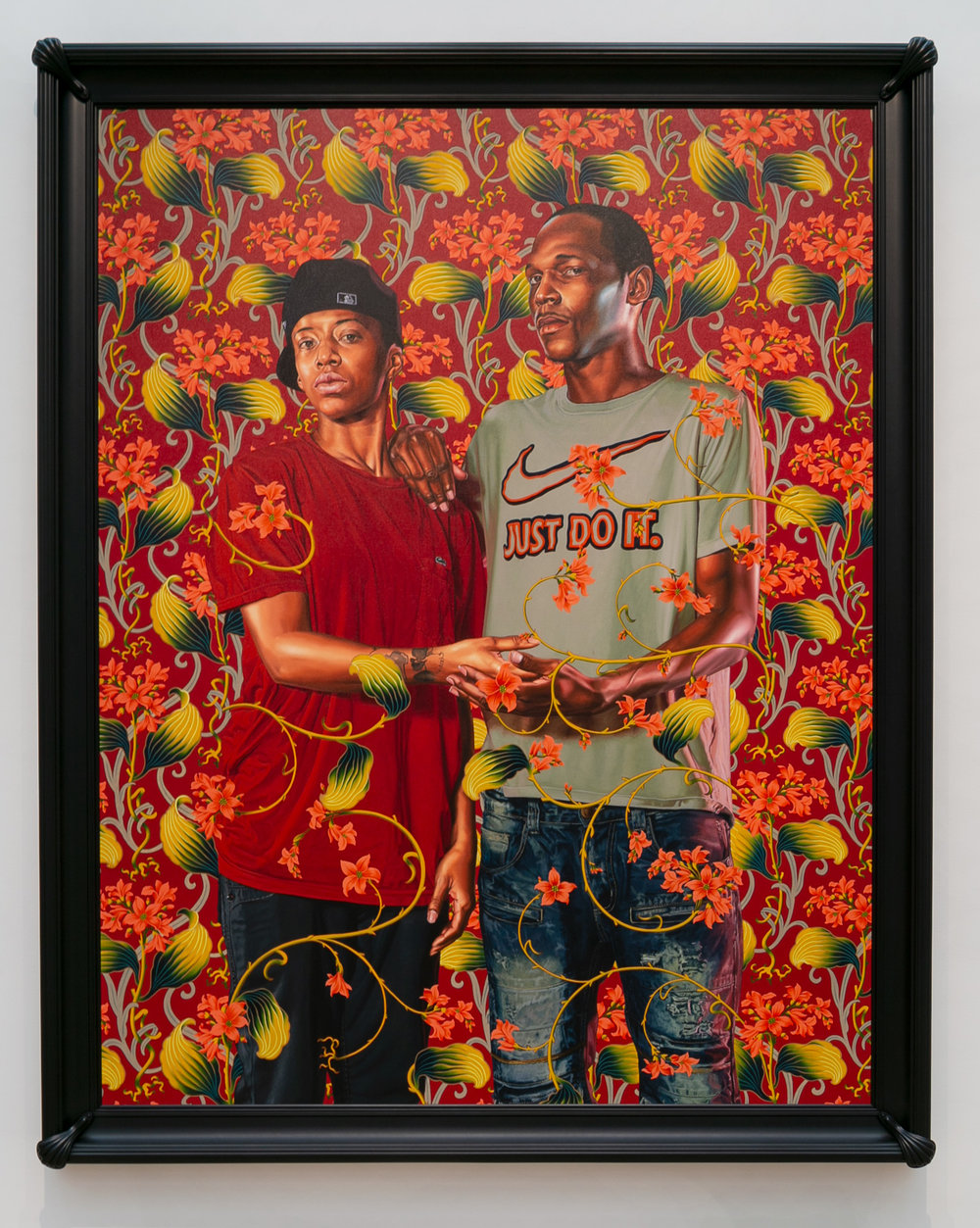 "Kehinde Wiley, ""Portrait of Mahogany Jones and Marcus Stokes"" (2018), oil on linen, image: 108 × 84 inches, framed: 119 × 95 × 6 inches, Saint Louis Art Museum"