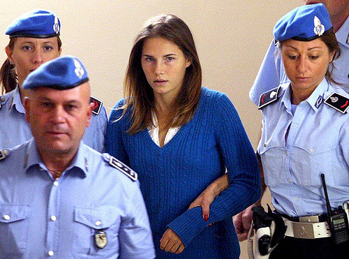 Amanda Knox escorted by Italian police.