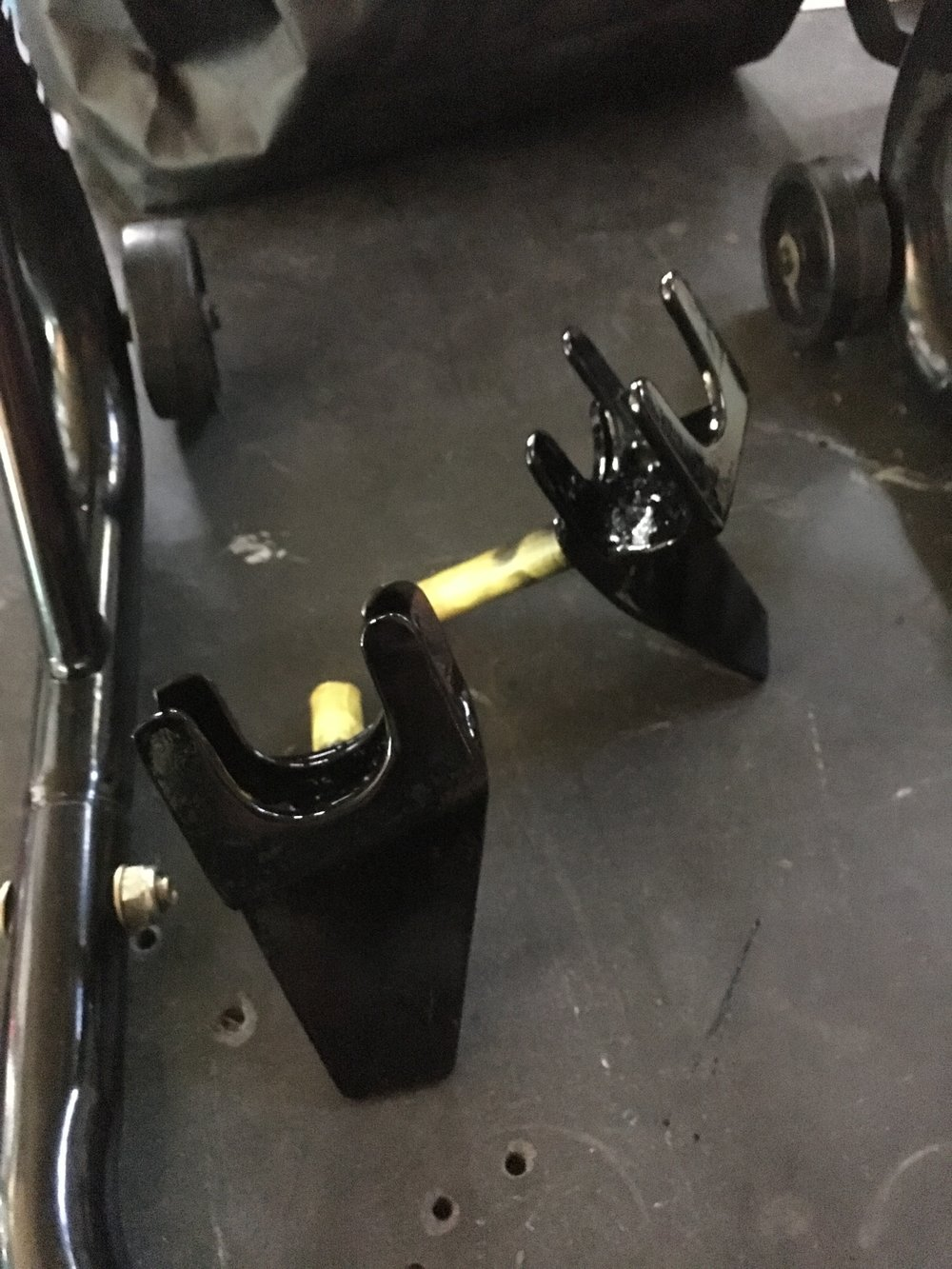 Some special fittings made for the front fork wheel stand to allow wheel removal. Since there is a belly pan and no frame under the front of the engine, there is no good jack point.
