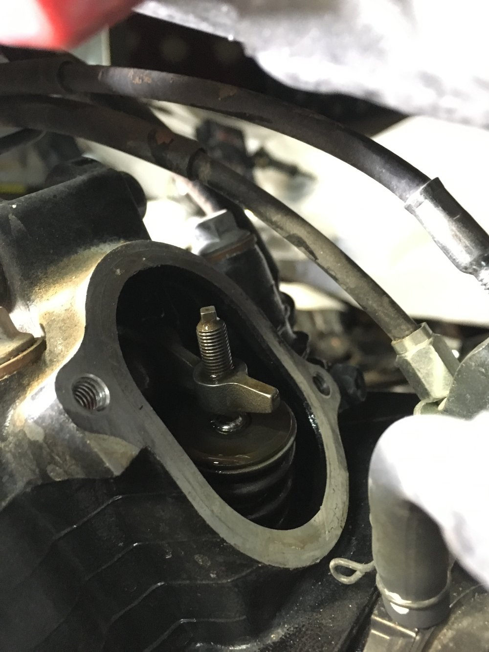 The culprit on the TW200 was a missing locknut on the valve adjuster. The nut was fished out of the head with a magnet, replaced, valves adjusted and the bike runs like new.