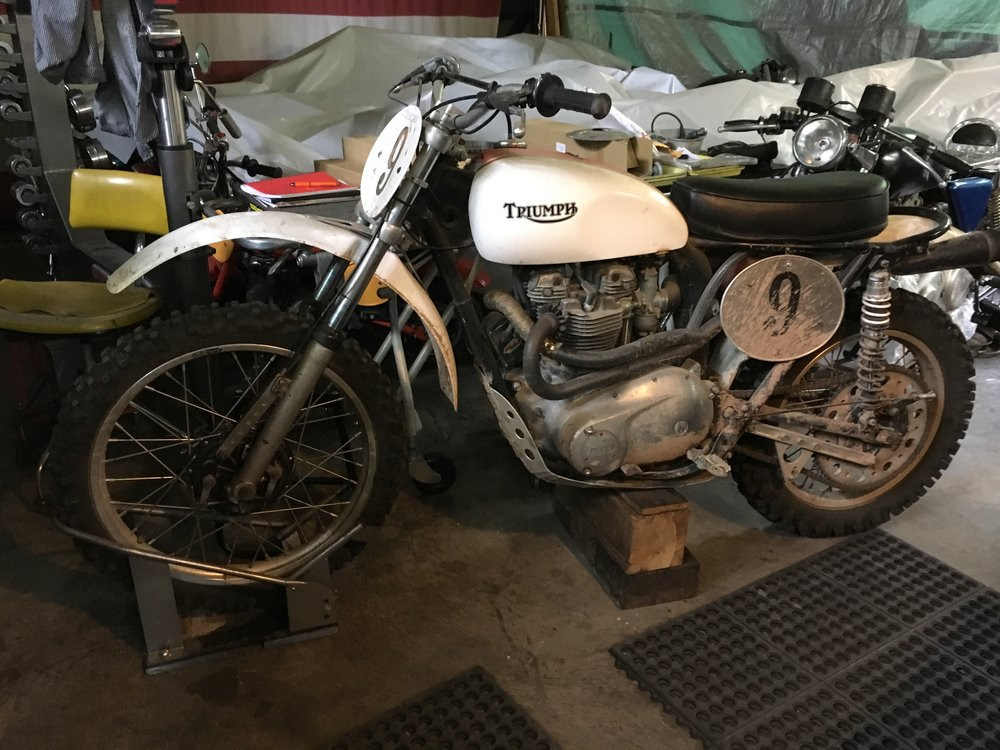 1971 Triumph TR6C oil in frame model here for a tank re-line, fork rebuild and revival. With a Joe Hunt Magneto set-up, fiberglass tank, plastic fender, custom bash plate, Husky front hub, Ceriani front forks, Works brand shocks, Renthal Desert bars, and a monster rear sprocket, this one is ready to chew some dirt.