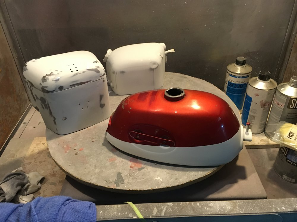 A lot of work went into the Z50 tank, stripping a Kreem liner and replacing it with some epoxy, and touching up the paint. Since there was paint being shot, the 1957 Triumph tins got thrown in.