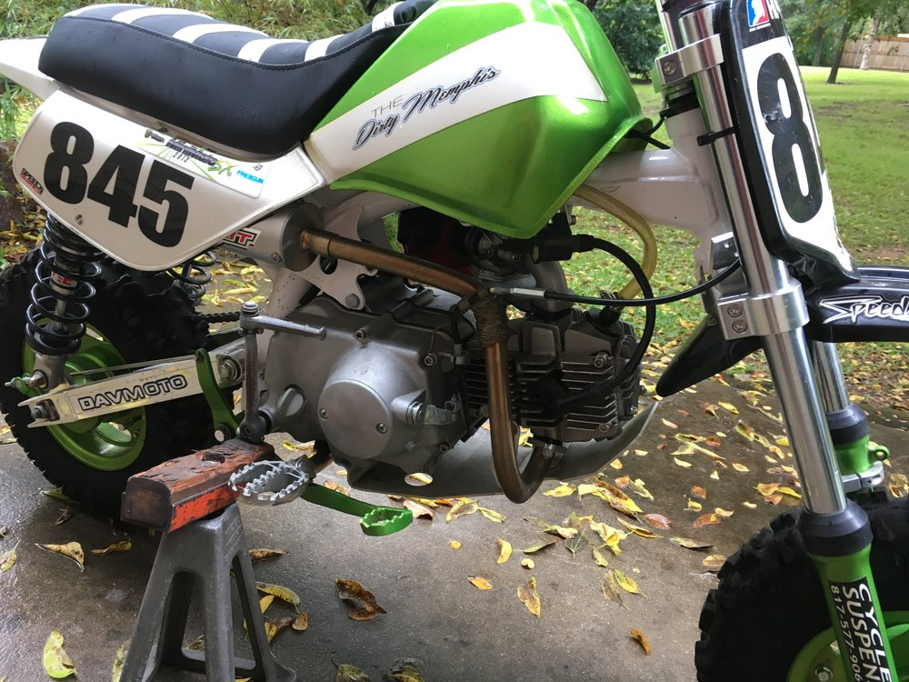 A Honda Trail Bikes ported race head and cam, 20mm carb and intake, 4-speed transmission, manual clutch, lightened flywheel, Pro Circuit pipe, extended brake pedal, heavy duty footpeg mount, and a Fast 50's skidplate went on a brand new OEM frame. There are few hours on this bike, and it is FOR SALE! Contact me if interested.