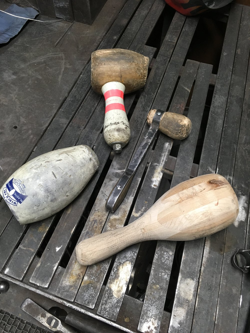Some of the low-tech homebrew tools used in the aluminum pounding. Bowling pins are pretty easy to find and their hard oak composition makes them great tor pounding.