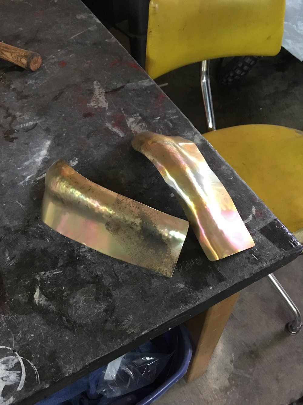 This is after a couple rounds of beating on the shot bag with a small ball-peen. Between each round of beating, the metal is annealed, or heated to get rid of work-hardness in the metal.