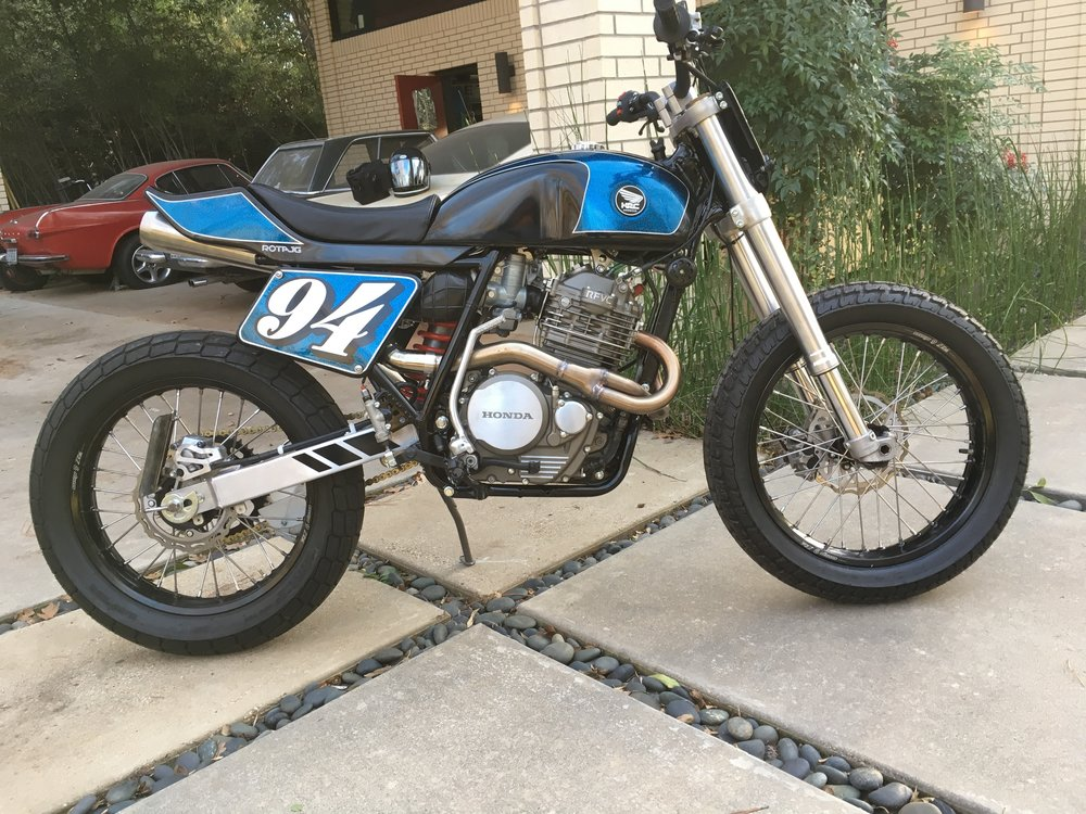 John Green rode by on his latest build, a killer Honda XL600 custom tracker. Just beautiful!