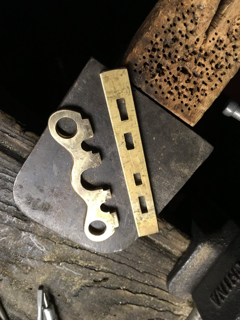 Eighth inch brass plate was used to make the locking lever.