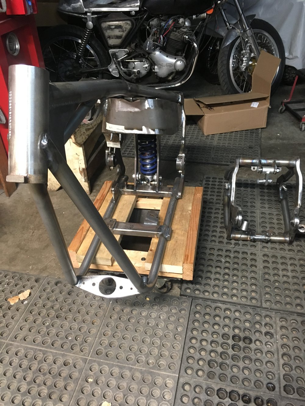 The frame came with an MSO (Manufacturer's Statement of Origination) and a VIN stamp, so it should be easy to register. The swingarm uses spherical bearings and is as beefy as the rest of the frame.