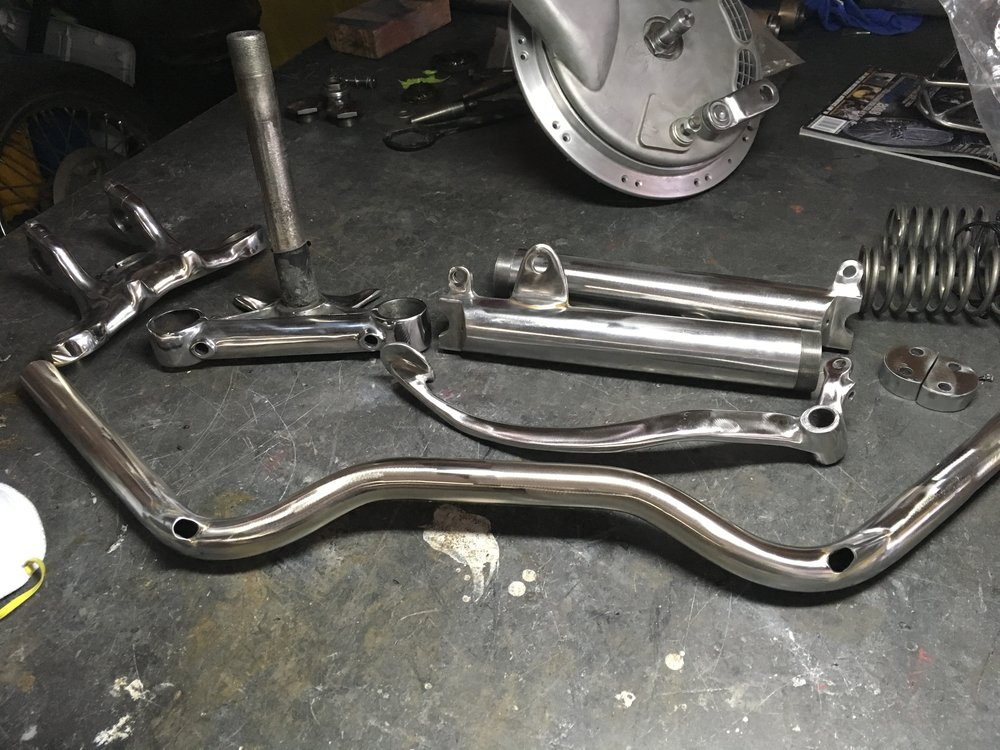 The handlebars and brake pedal got some more attention. The cable exits were finished out on the bars, and a bunch of contouring and shaping was done on the pedal.