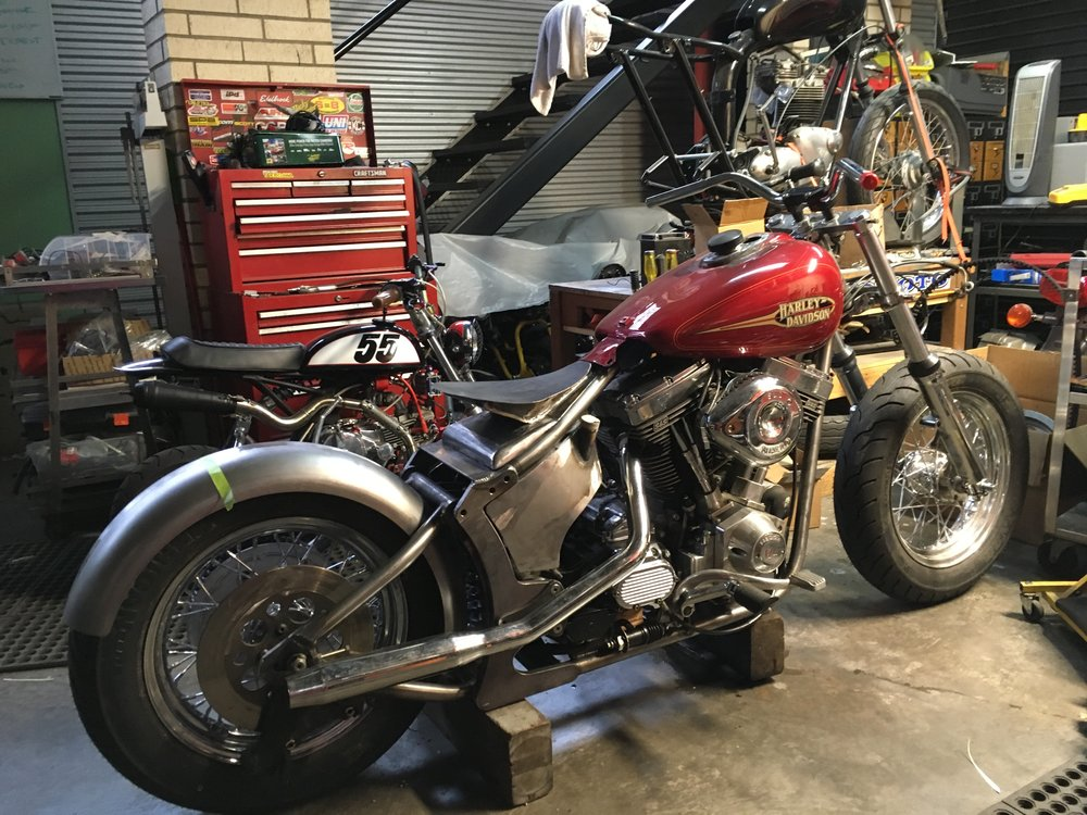 The 1993 Harley-Davidson FXR project is moving along as well. The rear fender and a second set of handlebars with a little more pull-back are on the bike, and the pipes are getting worked out. The rear pipe was part of a used set purchased online, but unfortunately, the front pipe could not be found by the seller! A second set was purchased and is on the way.