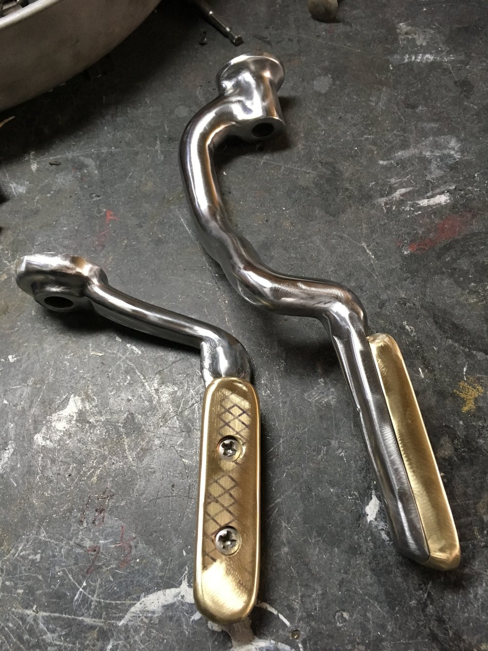 The original footpeg brackets were modified to accept some brass foot rests.
