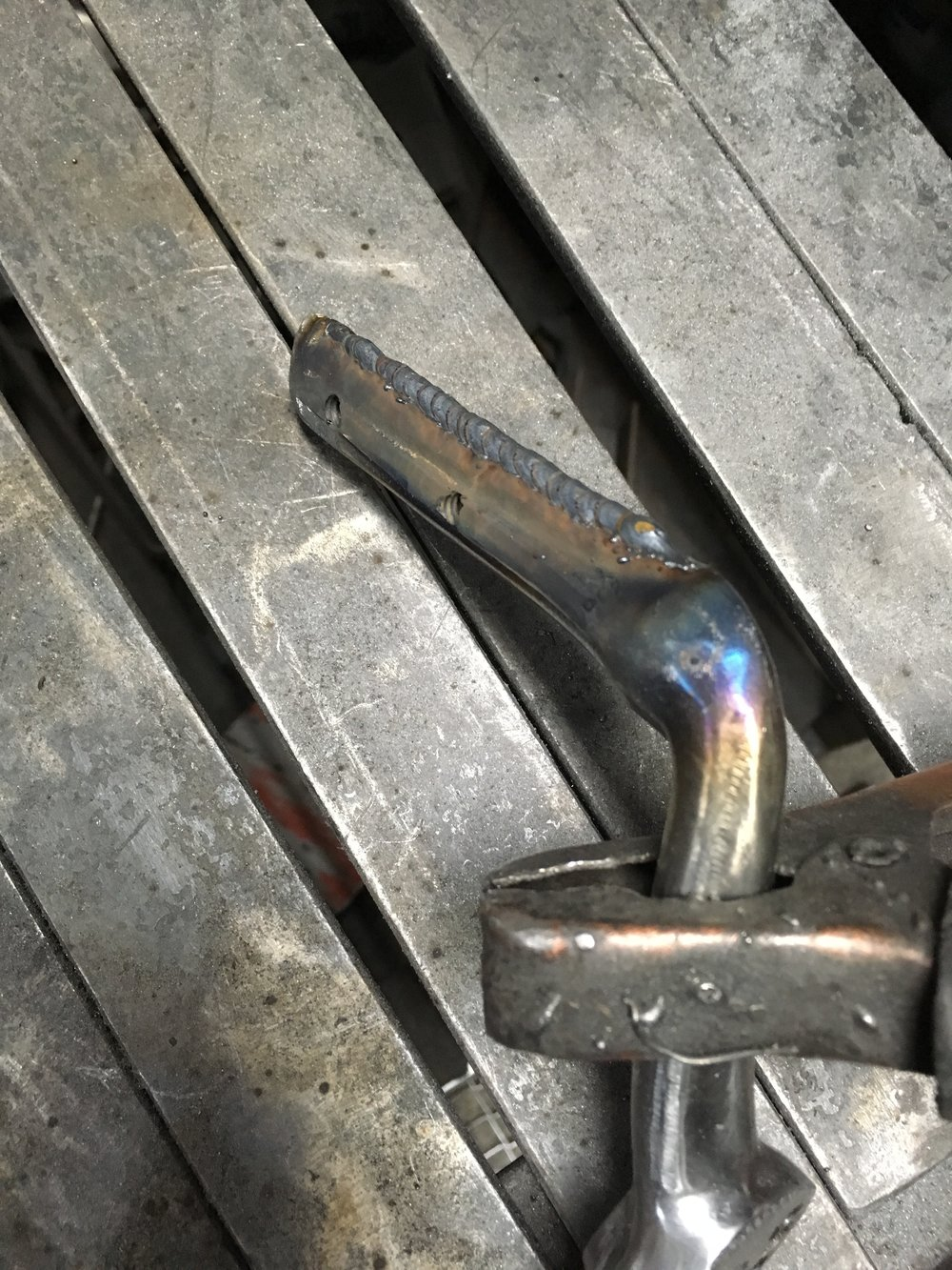 After the top was ground flat, holes were drilled and tapped, and the sides widened by welding.