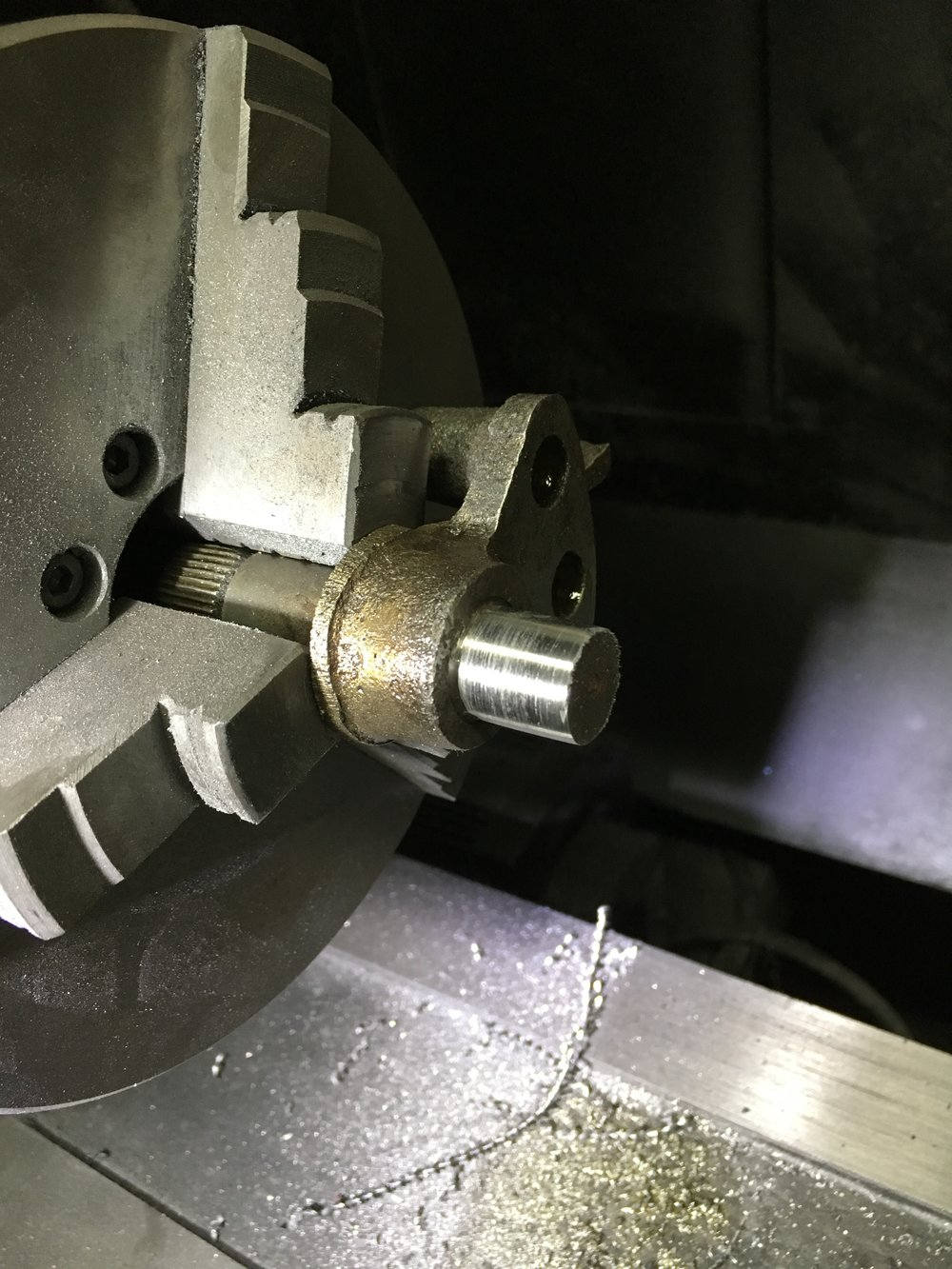 Chucking it up in the lathe allowed it to be taken to the right level. This is the after of the same surface.