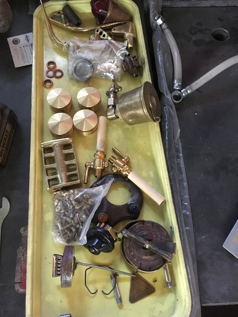 The pile of brass accessories. All the brass will need to be worked over to get the finishes more uniform. One of the great things about brass is the many hues it can produce when patinated.