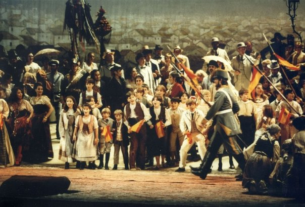 Bryan (center, in brown vest) in the 1996-97 Zeffirelli production of Carmen.