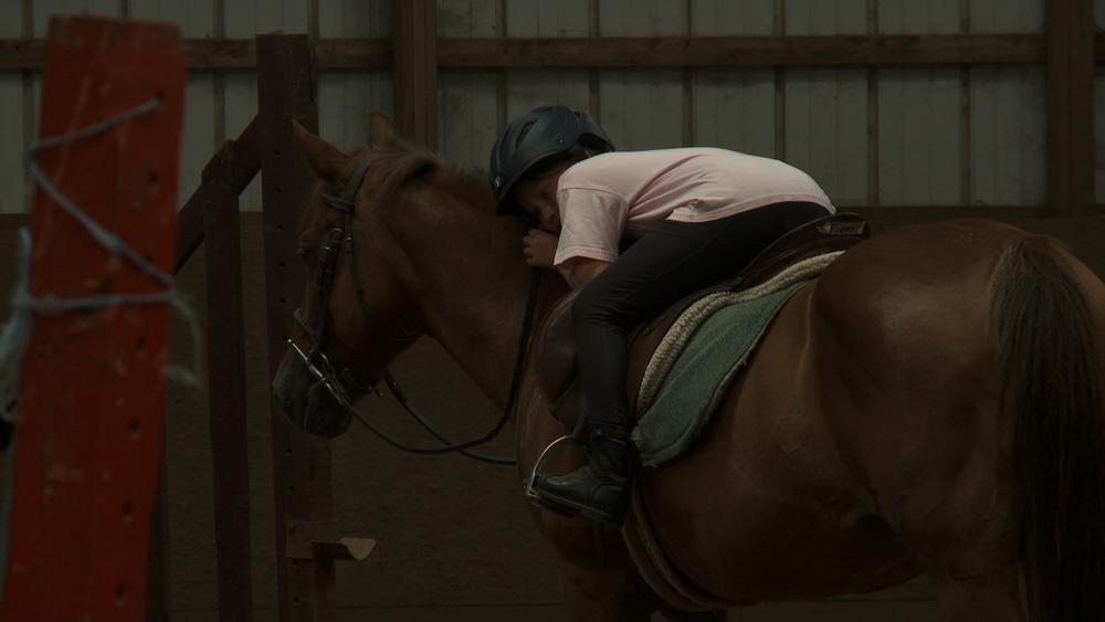 kid lying on horse.jpg