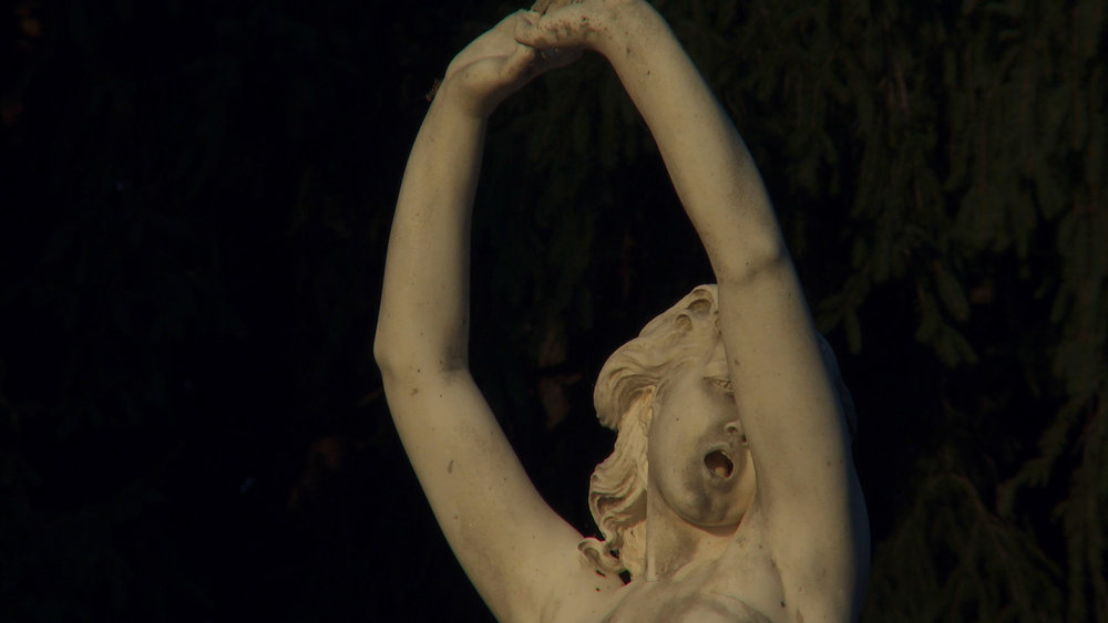 fountain statue arms up.jpg