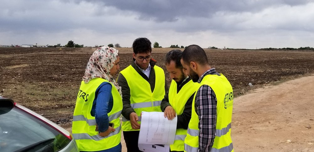 Fireseeds North meets with clients to review drawings in the field during a road safety audit.