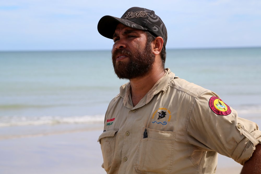 Phillip Mango - Phillip Mango grew up on Cape York peninsular and now works as a Senior Nanum Wungthim Land and Sea Ranger. The 'saltwater country' he looks after includes some of the most intact coastal and marine habitats in the world. It is one of the last great strongholds for globally threatened turtles and dugongs and supports some the world's largest mangrove forests, coral reefs and seagrass meadows. It also has one of the most intact traditional Indigenous knowledge-based management regimes on the planet.The Nanum Wungthim Rangers operate a highly successful sea turtle rescue operation and manage one of the regions hotspots for ghost nets. Working with Ghostnets Australia, Phillip leads a team of six hardworking rangers all of whom are passionate about their coastline, rescuing injured marine life and removing ghost nets from their coastline each year.Working closely with Cairns Turtle Rehabilitation Centre, Phillip and the rangers have restored many injured turtles back to health in addition to monitoring and recording data on the breeding, hatching and nest sites of our endangered marine turtles. Collectively they have rescued over 300 entrapped turtles and removed 13,000 nets from the Gulf of Carpentaria.
