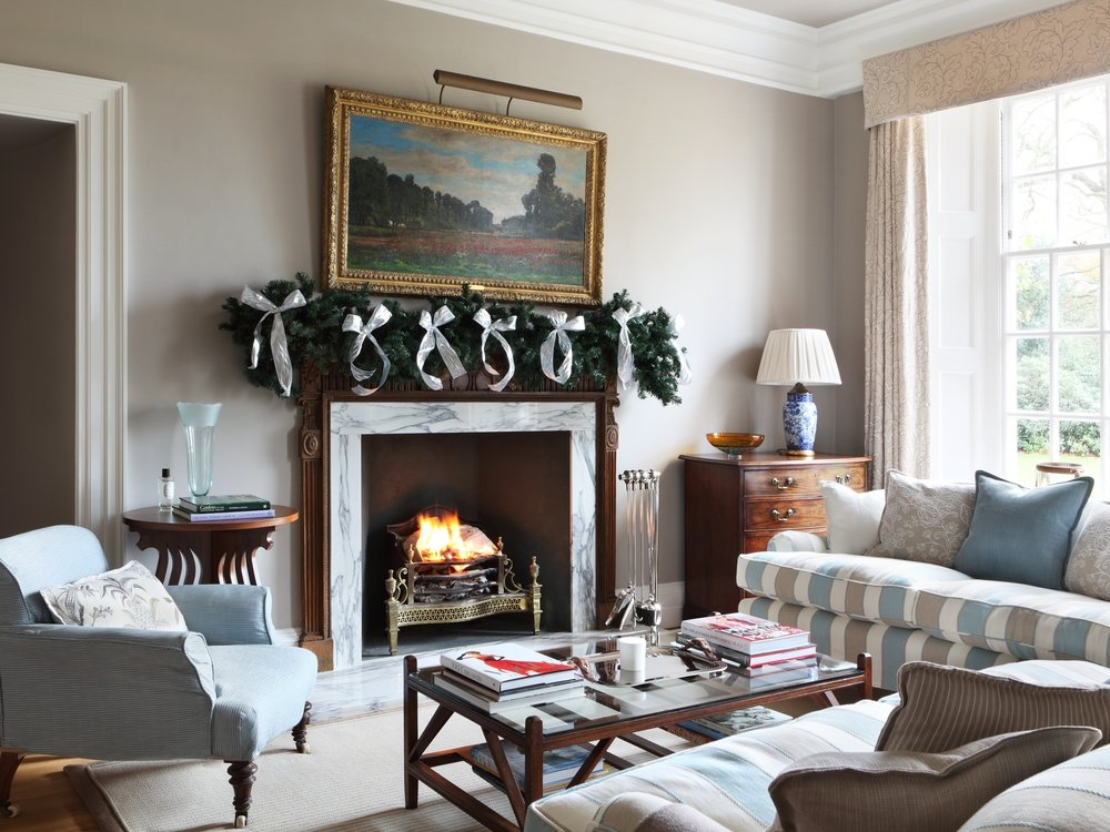 This is from our project The Manor House in Essex at christmas time. A roaring fire and decked out mantlepiece- perfection!
