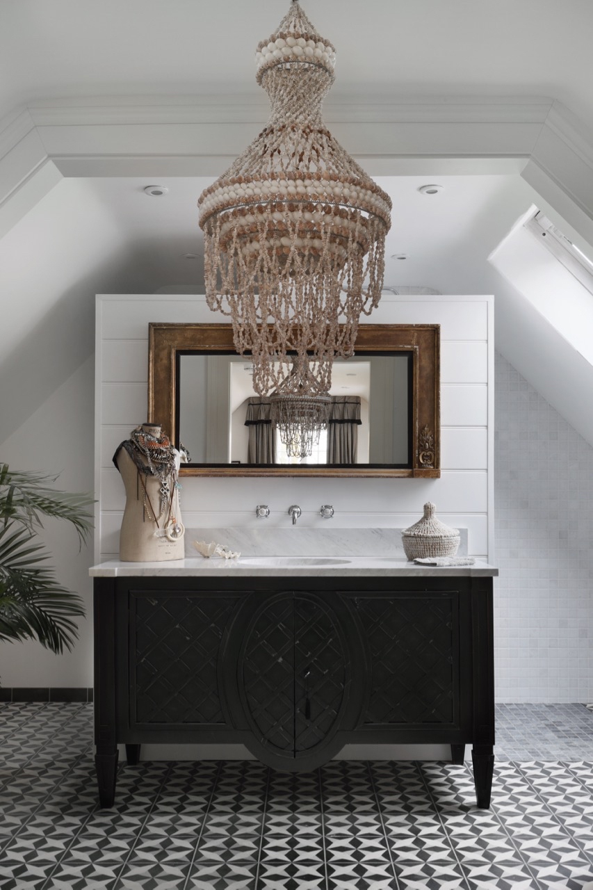 This is from one of our newest projects in our portfolio, The Stables. We love the shell chandelier, this adds a serious statement to an already beautiful bathroom. Click here to see the entire project.