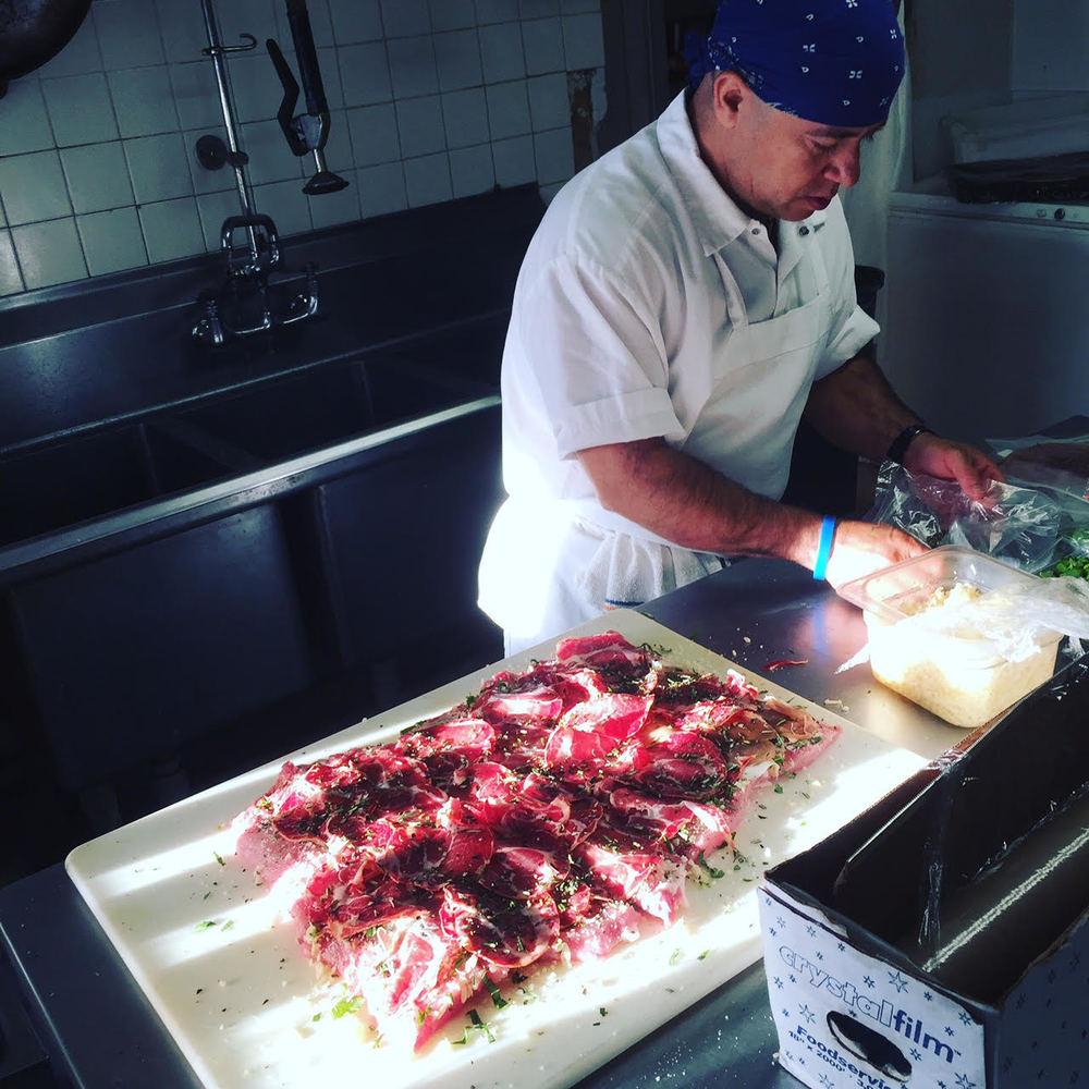 Fernando making Porchetta
