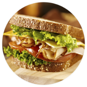 Turkey Sandwich with cheese, lettuce and tomato