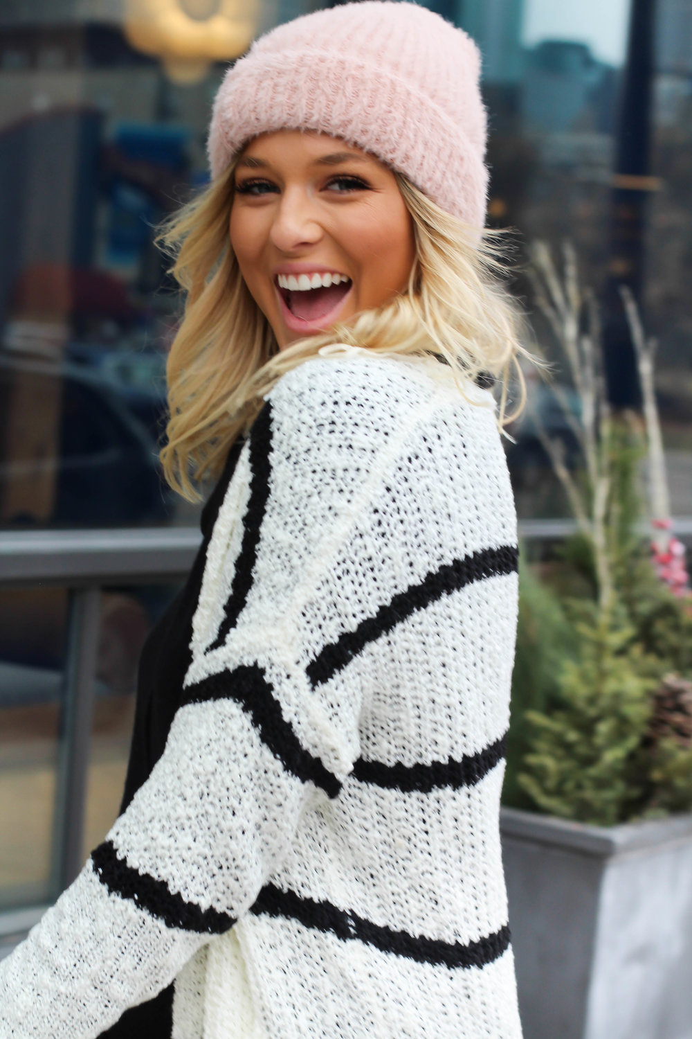 cardigan $38 ,  sweater $34 ,  hat $12