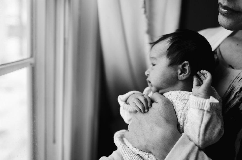 newborn holding momma's hand.jpg