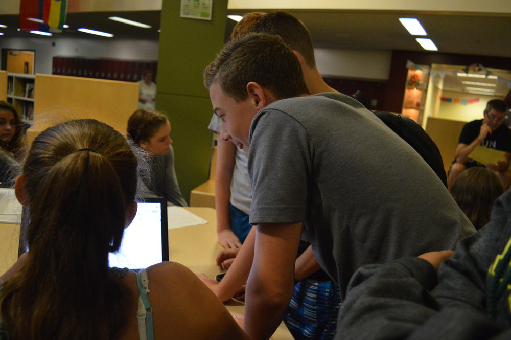 Here is the President of Jr. Scoop, Carson Puppo, and one of our members working on our website.