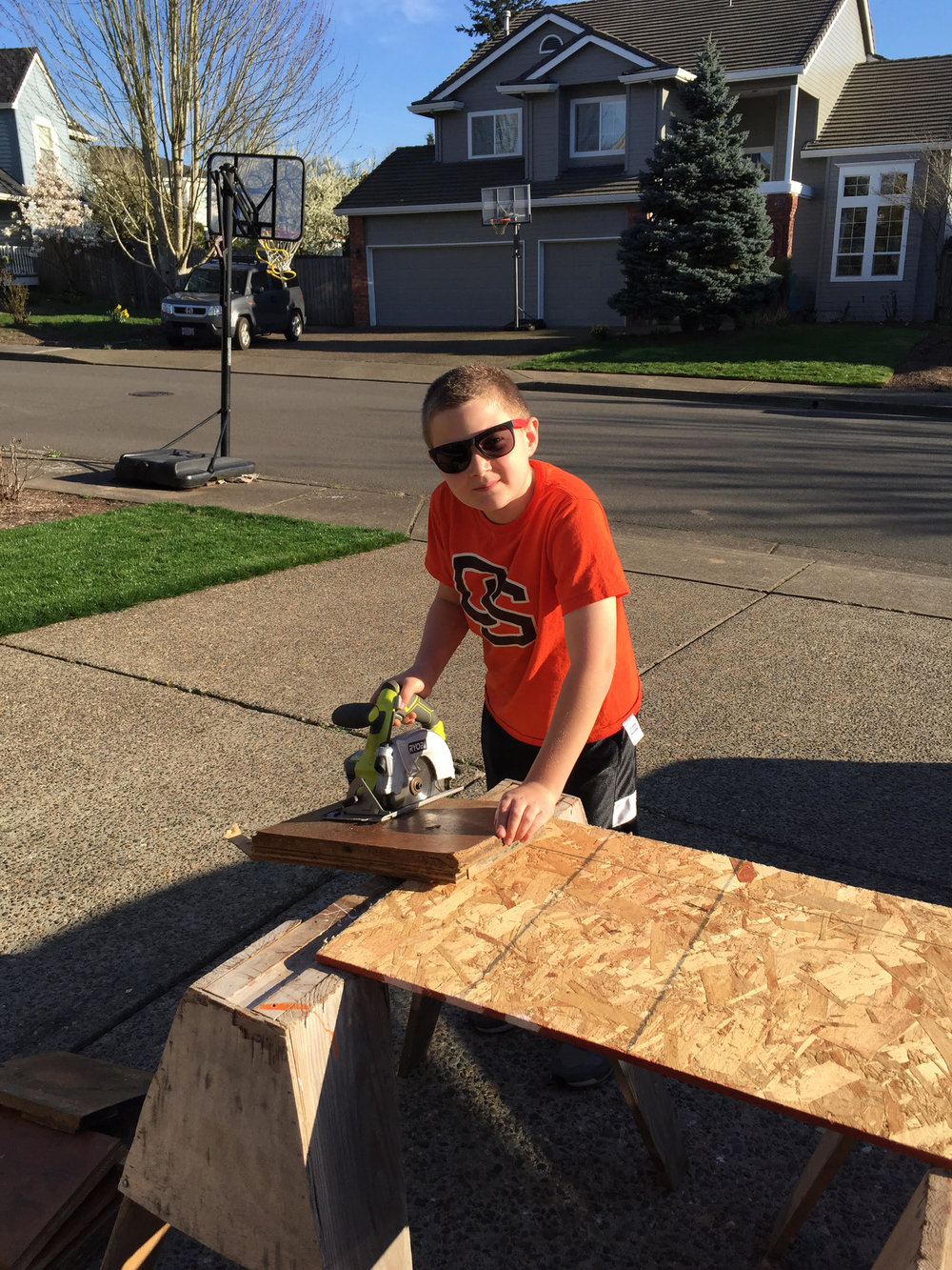 Here is Carson Puppo cutting wood for a furniture project.