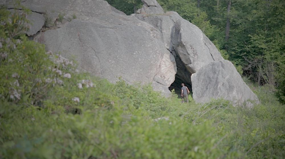 Peter enters the cave.  Video still from a forthcoming project on synthesizer makers.