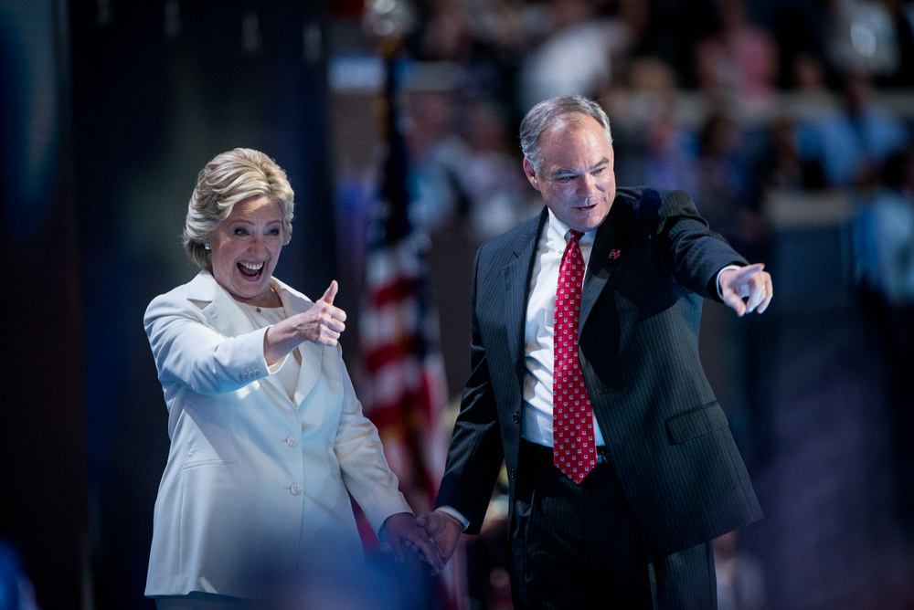 Democratic presidential nominee Hillary Clinton and vice presidential nominee Senator Tim Kaine,D-VA,celebrate their party's nomination at the Democratic National Convention inside the Wells Fargo Center in Philadelphia on Thursday July 28, 2016. (Michael Ares /Philadelphia Inquirer)