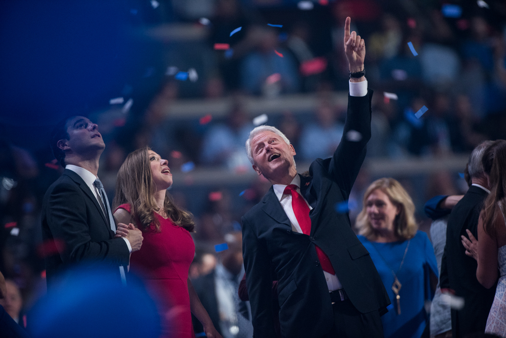 Former president Bill Clinton points to balloons released at the end of the Democratic National Convention inside the Wells Fargo Center in Philadelphia on Thursday July 28, 2016. (Michael Ares / Philadelphia Inquirer)