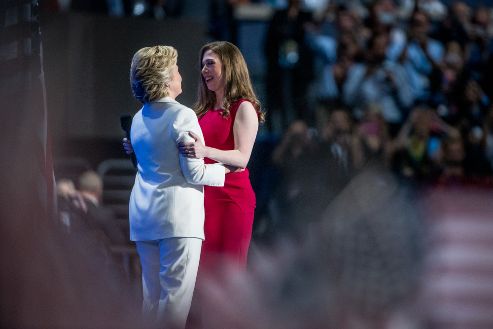 Chelsea Clinton embraces Democratic presidential candidate Hillary Clinton during the Democratic National Convention inside the Wells Fargo Center in Philadelphia on Thursday July 28, 2016. (Michael Ares / Philadelphia Inquirer)