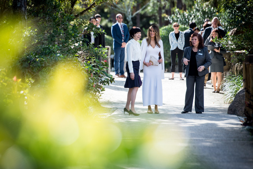 First Lady Melania Trump, center, and Akie Abe, wife of Japanese Prime Minister Shinzō Abe listen as Park Administrator Bonnie White Lemay, right gives a tour of the Morikami Museum and Japanese Gardens in Delray Beach, Fla., on Saturday, Feb. 11, 2017. (Michael Ares / The Palm Beach Post)