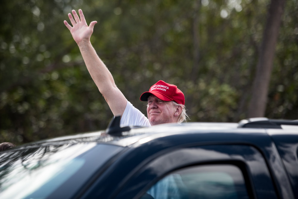 President Donald J. Trump waves to his supporters as the presidential motorcade crosses the Bingham Island Bridge in Palm Beach, Fla., on Saturday, Mar. 4, 2017. (Michael Ares / The Palm Beach Post)