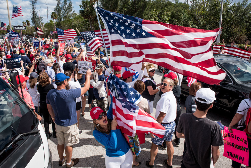 Trump supporters rally together on Bingham Island in Palm Beach, Fla., on Saturday, Mar. 4, 2017. The president's motorcade passed through with President Donald J. Trump stepping out of his vehicle to wave to his supporters before continuing on in the direction toward Mar-a-Lago. (Michael Ares / The Palm Beach Post)