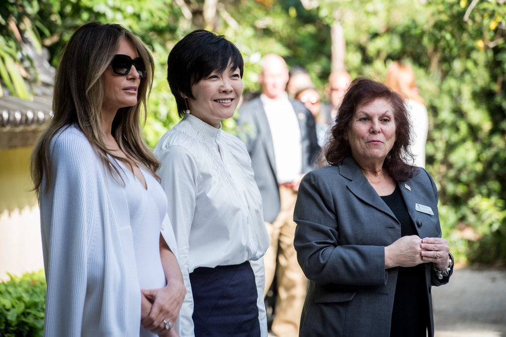 First Lady Melania Trump, left, and Akie Abe, wife of Japanese Prime Minister Shinzō Abe listen as Park Administrator Bonnie White Lemay, right gives a tour of the Morikami Museum and Japanese Gardens in Delray Beach, Fla., on Saturday, Feb. 11, 2017. (Michael Ares / The Palm Beach Post)