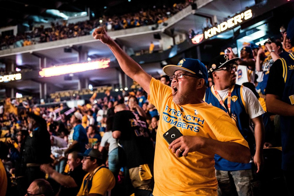 Pittsburg resident, Ed Casuga,  cheers with the crowd during an NBA Finals Game 6 Warriors Watch Party at Oracle Arena in Oakland, Calif., on Tuesday, June 16, 2015.  (Michael Ares/Special to the S.F. Examiner)