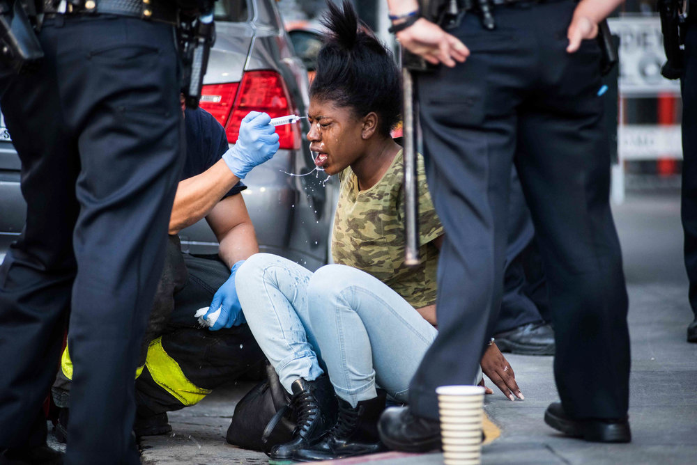 An alleged shoplifter is treated by San Francisco paramedics after being pepper sprayed by a police officer during a fight outside of a Union Square retailer on Tuesday, June 23, 2015. (Michael Ares / Special to the S.F. Examiner)