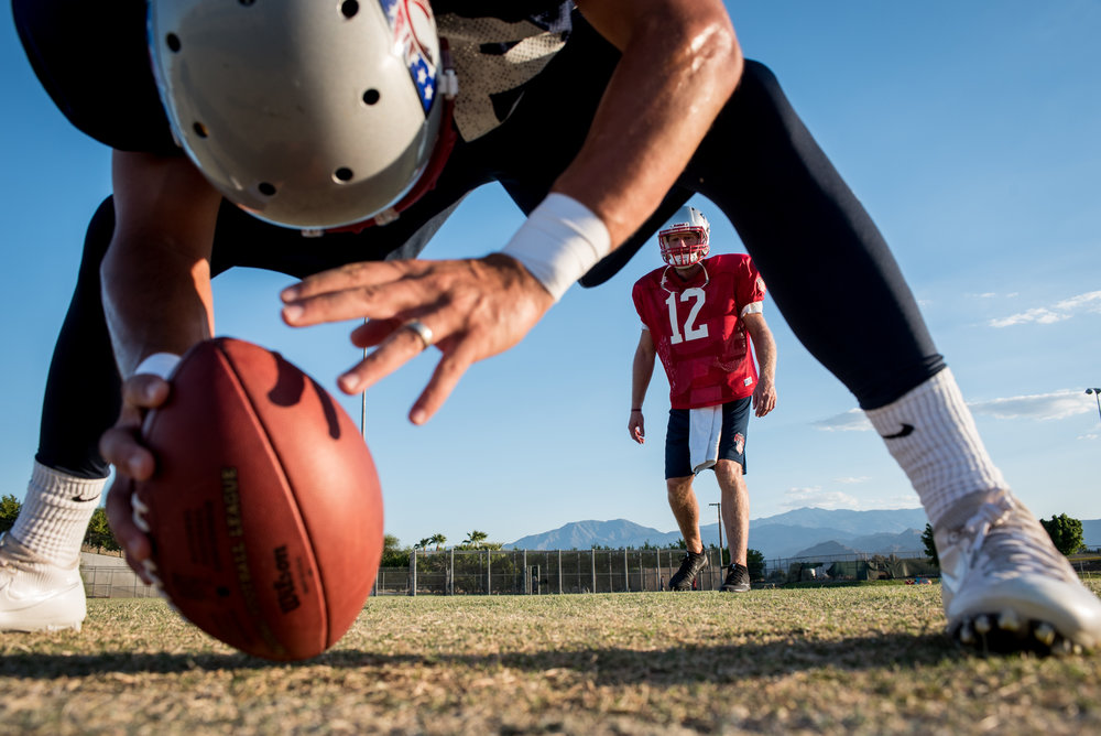 SoCal Coyotes long snapper Zach Koepp #38, left, prepares to snap the ball to quarterback Todd Marinovich #12, right, during practice at Shadow Hills High School in Indio, Calif., on Tuesday, Aug. 22, 2017. (Michael Ares for The New York Times)