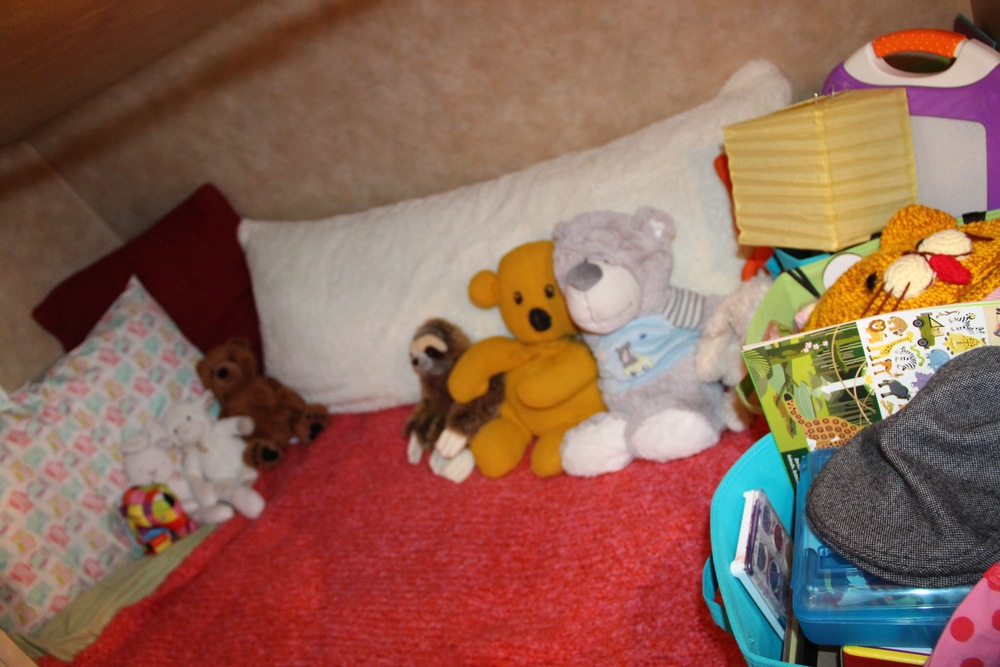 The bottom bunk, where she sleeps.