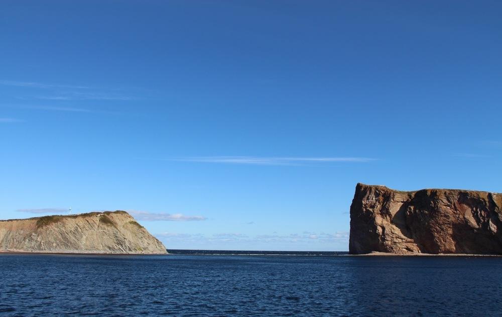 Between Percé and its rock.