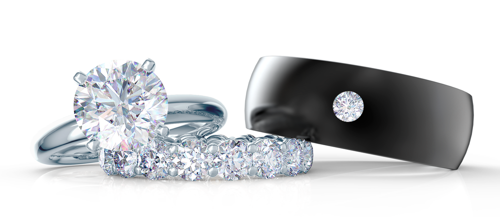 An engagement ring and two wedding bands from Ada Diamonds