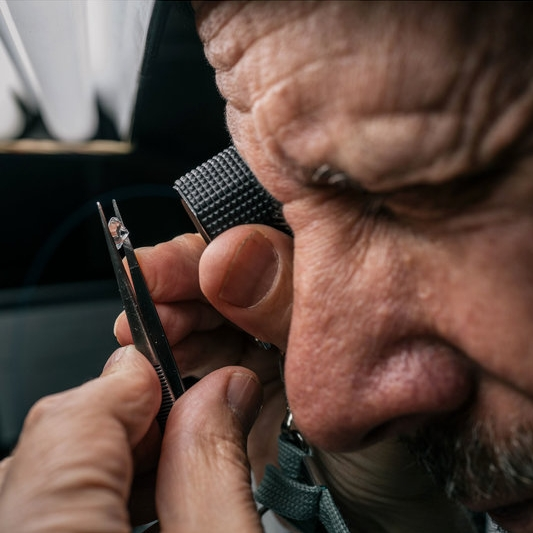 Weinstein inspecting a diamond. Photo credit: Michael Rubenstein for NPR